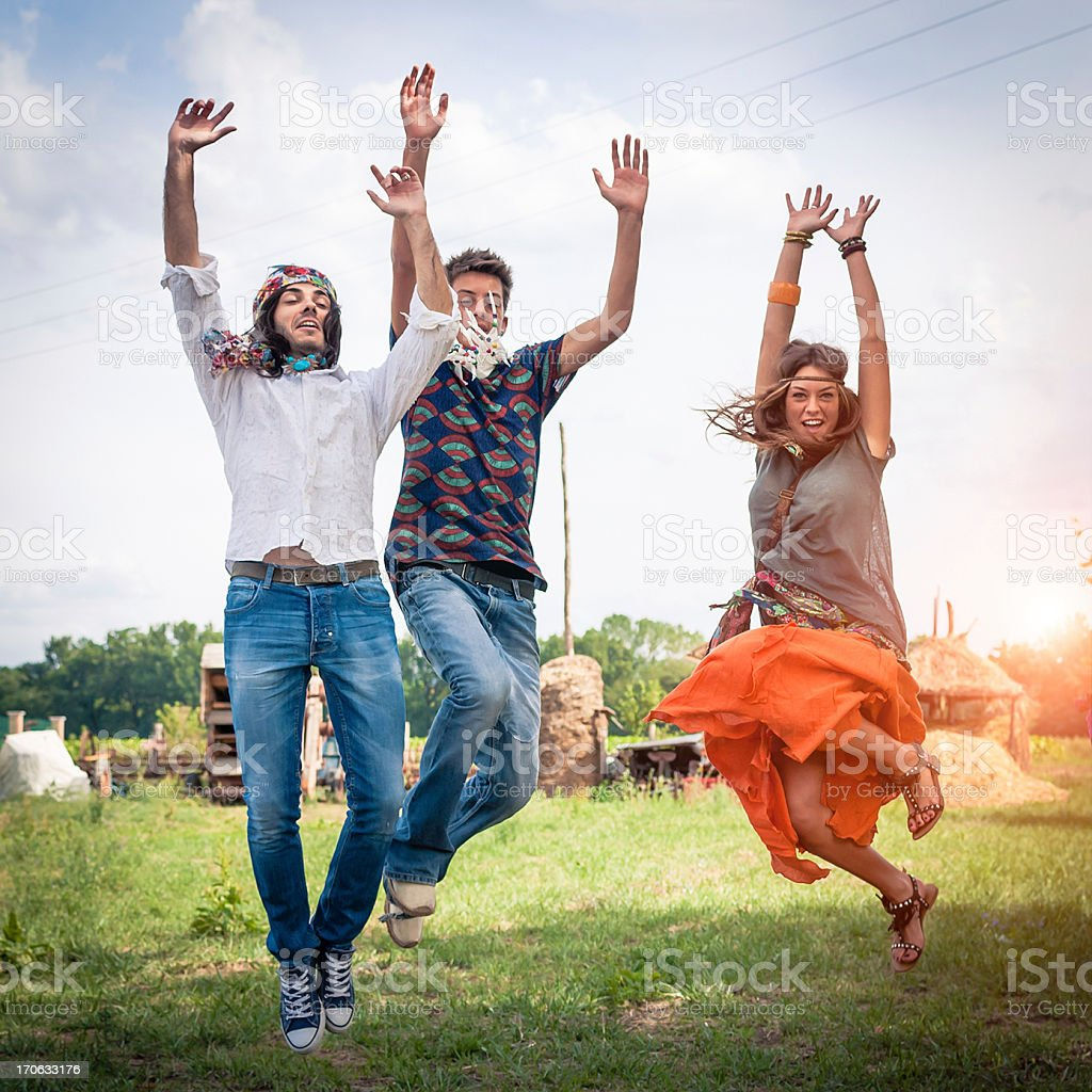 Group of hippie friends jumping royalty-free stock photo