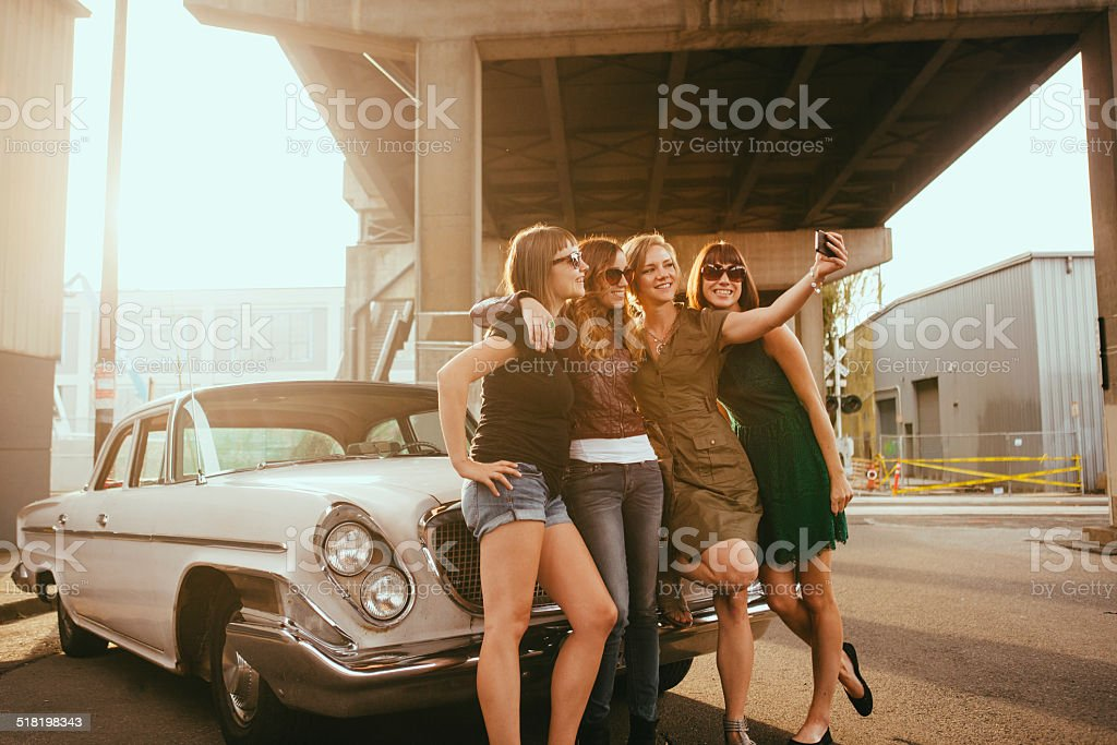 Group of Hipster Friends Take Selfie Together stock photo