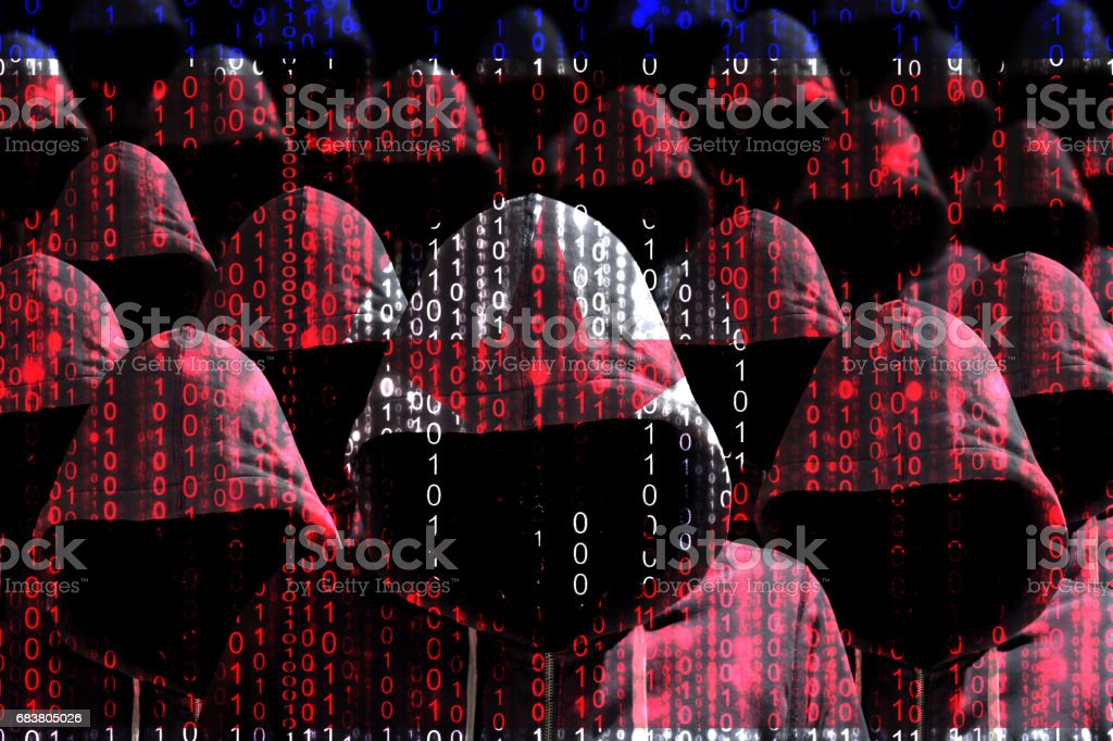 Group of hooded hackers shining through a digital north korean flag stock photo