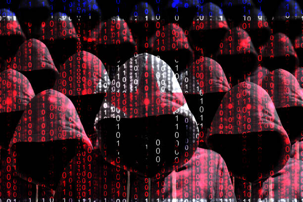 Group of hooded hackers shining through a digital north korean flag Group of hooded hackers shining through a digital north korean flag cybersecurity concept military attack stock pictures, royalty-free photos & images