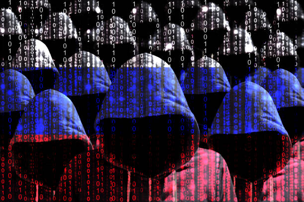 Group of hooded hackers shining through a digital russian flag stock photo