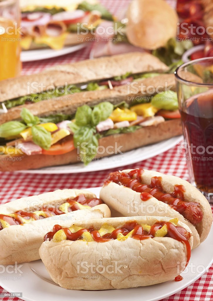 group of hot dogs, sandwiches and drink royalty-free stock photo