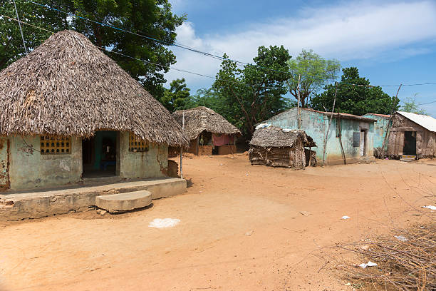 group of humble dwellings in village. - village stock pictures, royalty-free photos & images