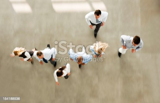 istock Group of hurry businesspeople entering the building. 154188536