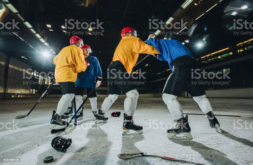 Group of ice hockey players fighting on ice hockey rink. stock photo