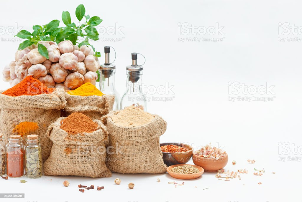 Group of indian spices and herbs on white background. stock photo
