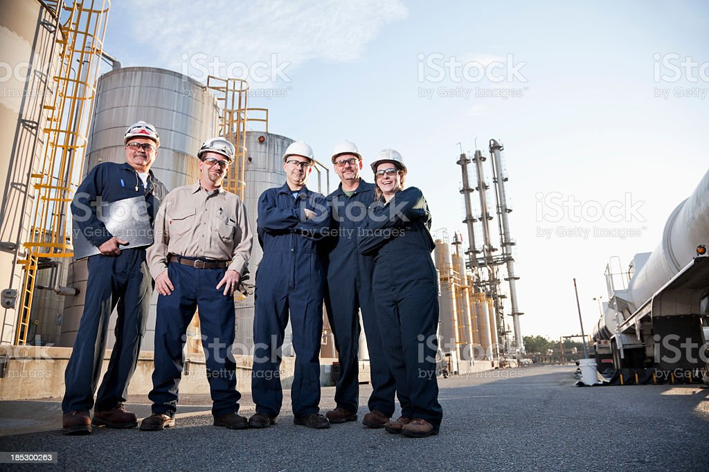 Group of industrial workers at chemical plant royalty-free stock photo