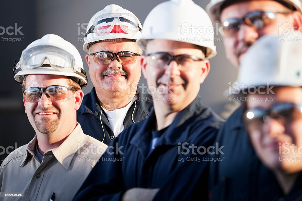 Group of industrial workers royalty-free stock photo