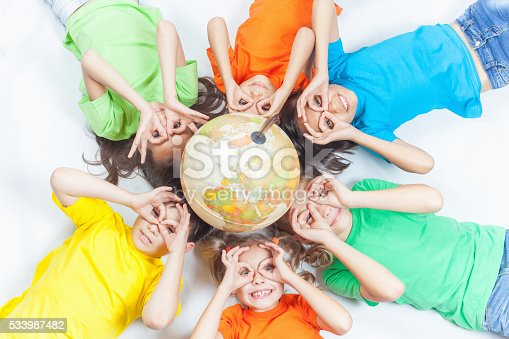 istock Group of international funny kids with globe earth 533987482