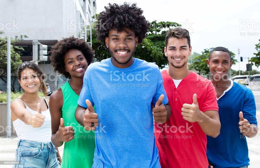 Group of international young adults showing thumbs in city Lizenzfreies stock-foto