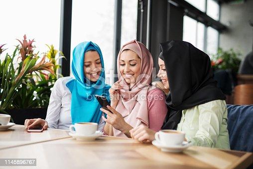 istock Group of islamic girls using smart phone 1145896767