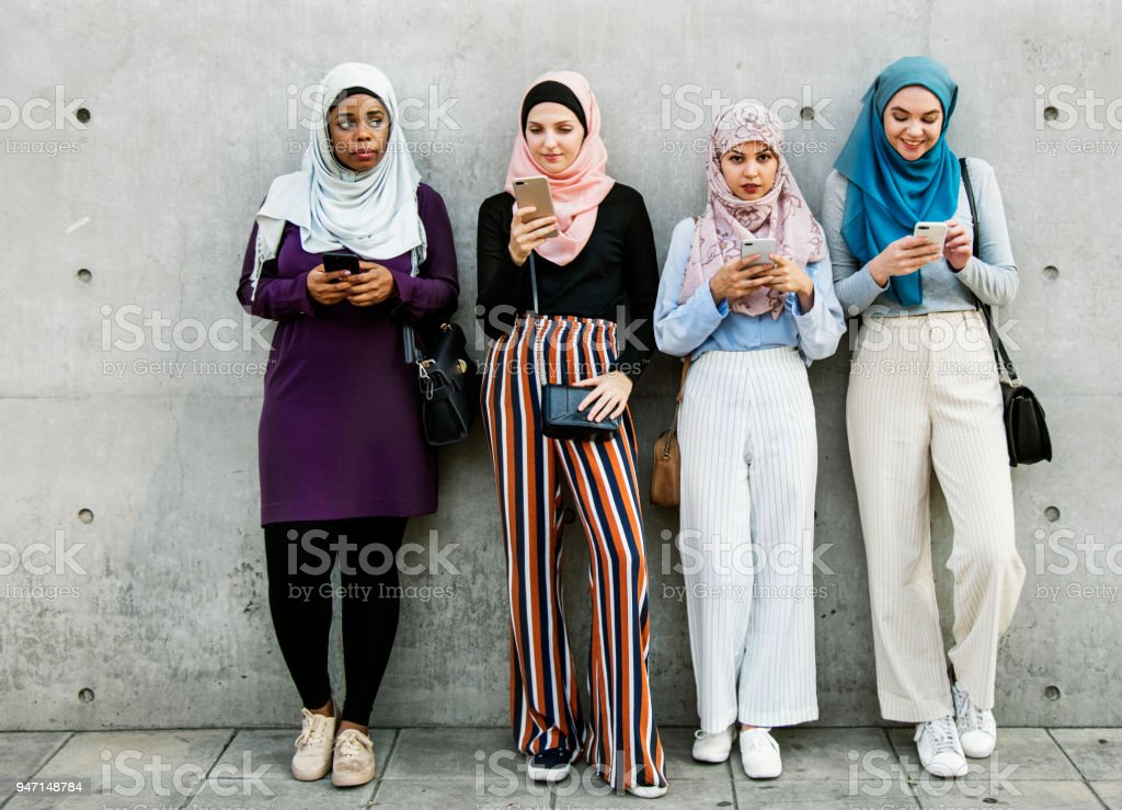 Group of islamic girls using smart phone stock photo