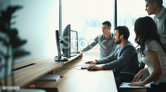 istock Group of IT experts in their office. 641204328