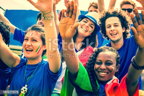 537894724 istock photo Group of Italian Footbal Team Supporters with Arms Raised 181072575