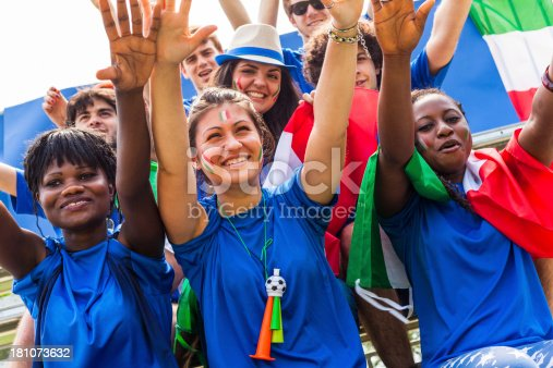 537894724 istock photo Group of Italian Footbal Team Supporters with Arms Raised 181073632