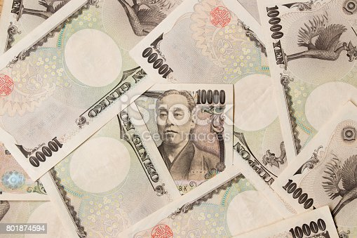 istock Group of Japanese bank note 10000 yen background 801874594