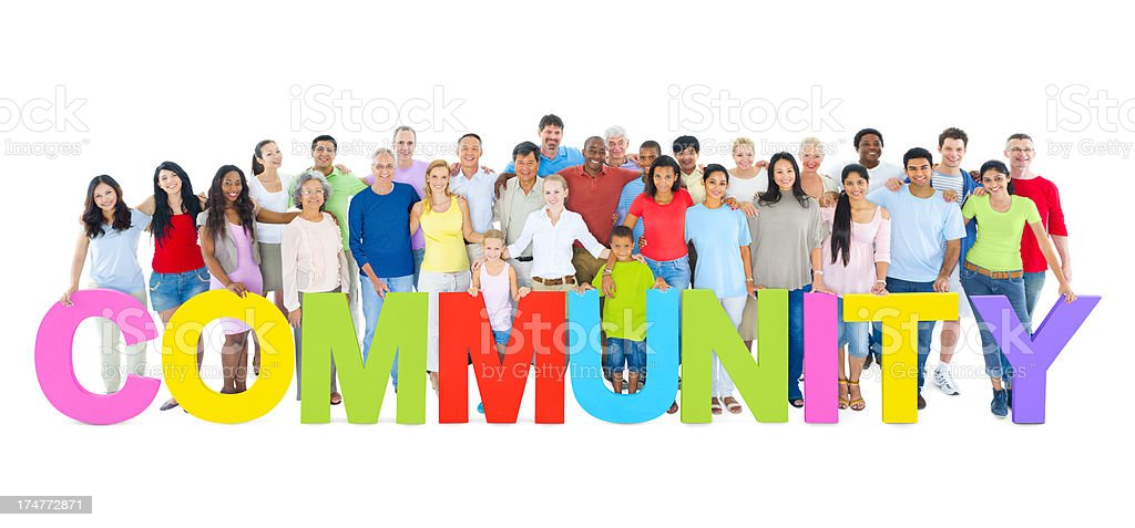 Group of joyful people standing with colorful word community royalty-free stock photo