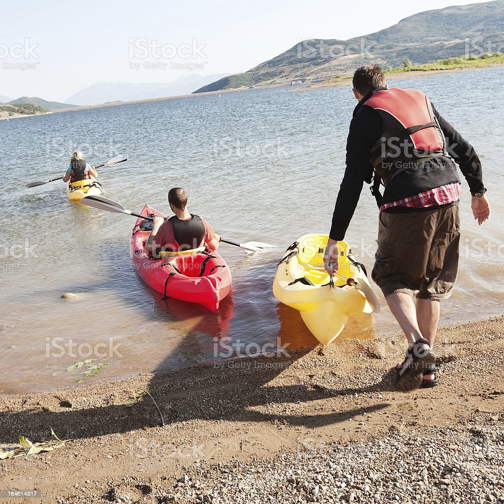 Group of kayakers heading out onto the water royalty-free stock photo