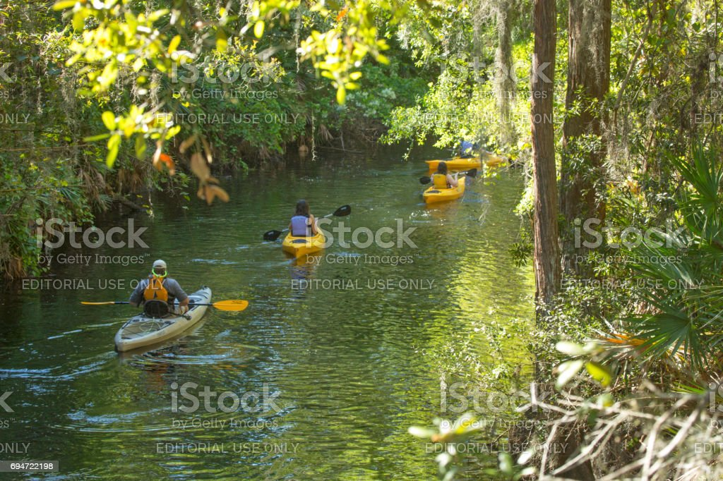 Group of kayakers on Shingle Creek in Kissimmee, Florida. stock photo