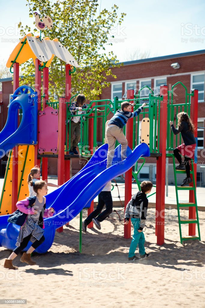 Group of kids active in school playground at recess.. stock photo