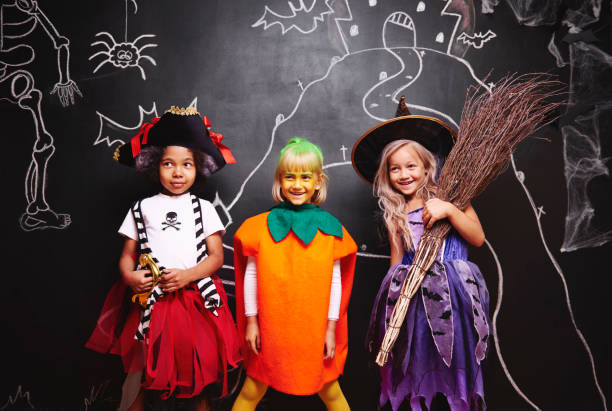 Group of kids at halloween Group of kids at halloween costume stock pictures, royalty-free photos & images