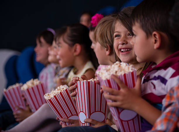 Group of kids at the cinema stock photo