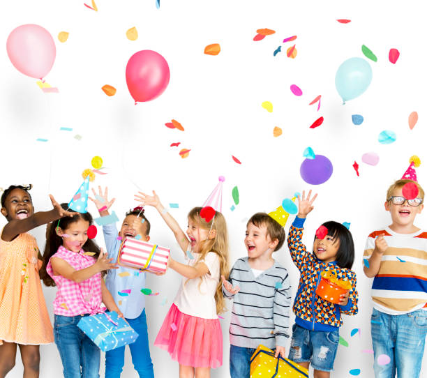group of kids celebrate birthday party together - infanzia foto e immagini stock