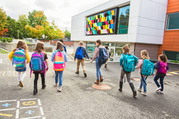 group of kids go to the school, Back view stock photo