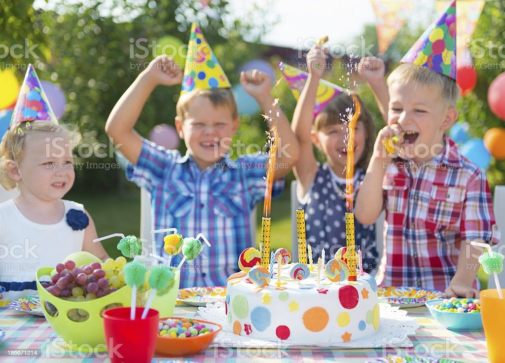 Group of kids having fun at birthday party royalty-free stock photo
