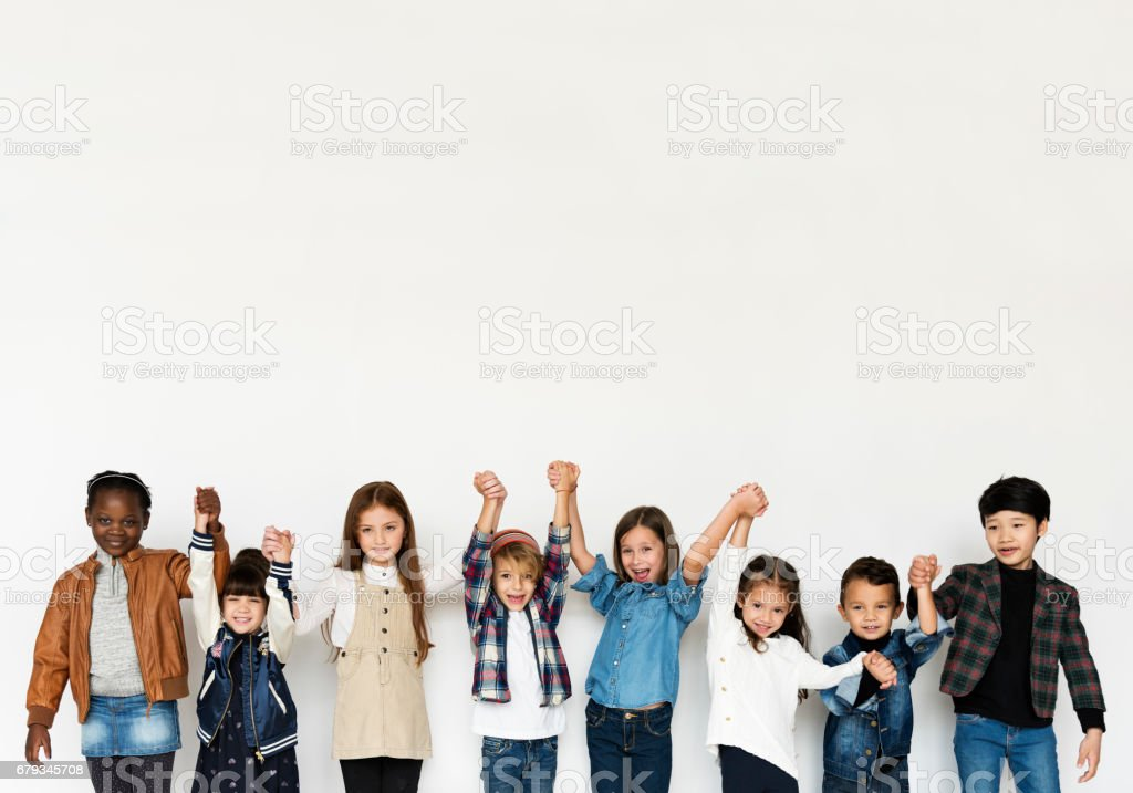 Group of Kids Holding Hands Face Expression Happiness Smiling on White Blackground stock photo