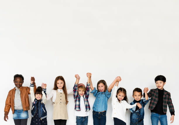 Group of Kids Holding Hands Face Expression Happiness Smiling on White Blackground Group of Kids Holding Hands Face Expression Happiness Smiling on White Blackground children only stock pictures, royalty-free photos & images
