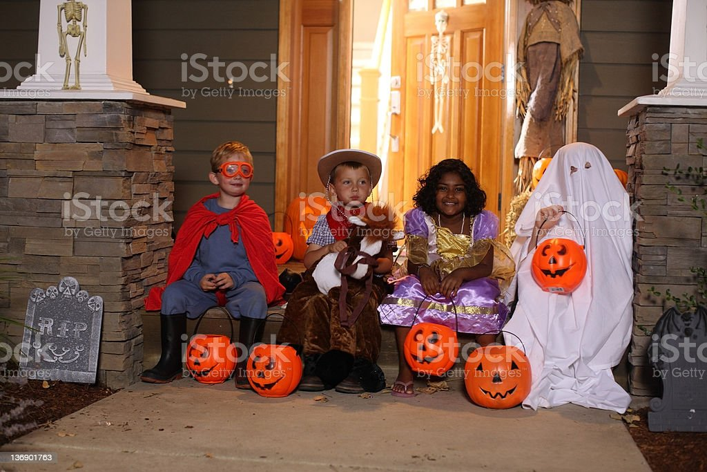 Group of kids in Halloween costumes stock photo