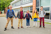 istock group of kids on the school background having fun 1176555205