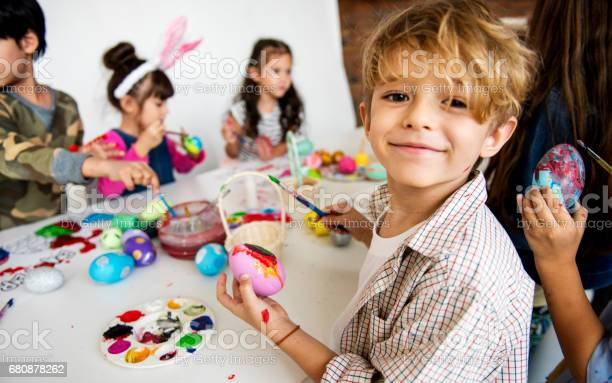 Group of kids painting easter eggs