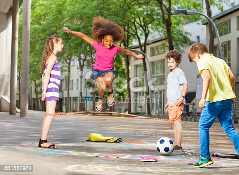 istock Group of kids play hopscotch on the school 831382974