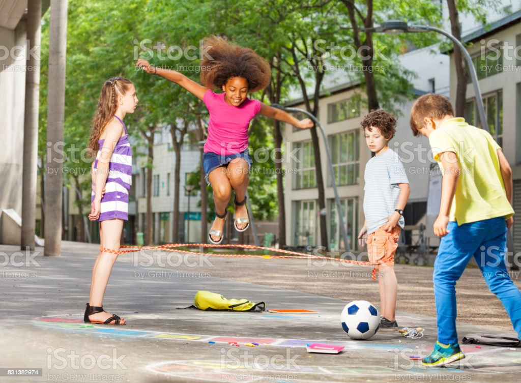 Group of kids play hopscotch on the school - foto stock