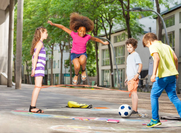 Group of kids play hopscotch on the school stock photo