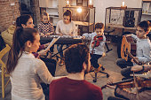 Group of kids teaching to play instruments in music school