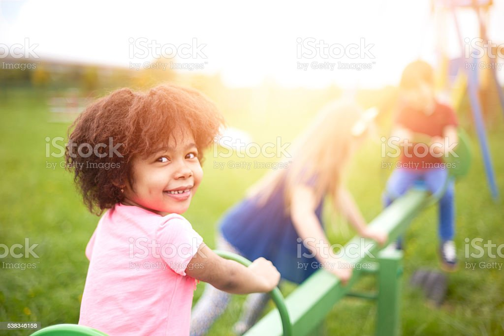 Group of kids playing together stock photo