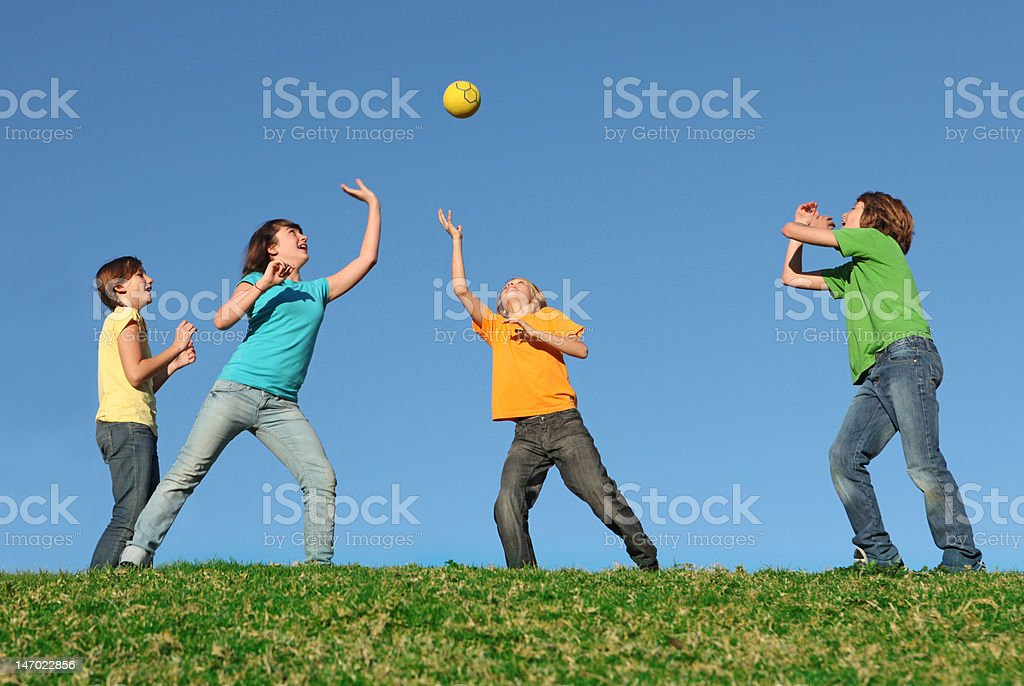 group of kids playing with ball stock photo