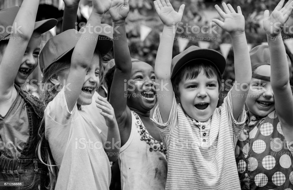 Group of kids school field trips learning outdoors active smiling fun stock photo