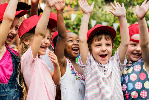 Group of kids school friends hand raised happiness smiling learning stock photo