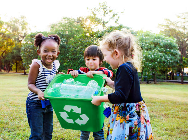 group of kids school volunteer charity environment - environmental conservation stock photos and pictures