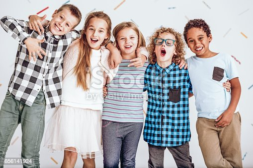 istock Group of kids standing in a row 656141924