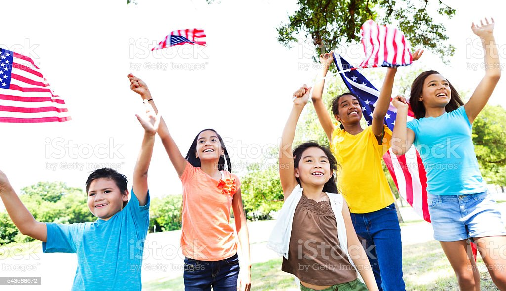 Group of kids wave American flags Independence Day parade stock photo
