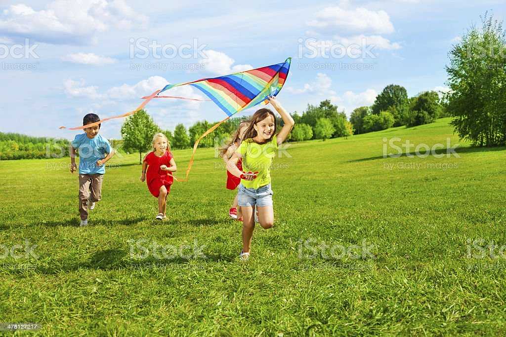 Group of kids with kite stock photo