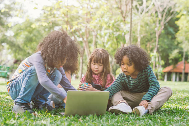 group of kids with laptop. stock photo