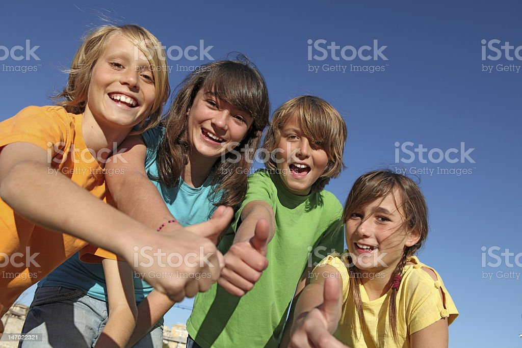 group of kids with thumbs up stock photo