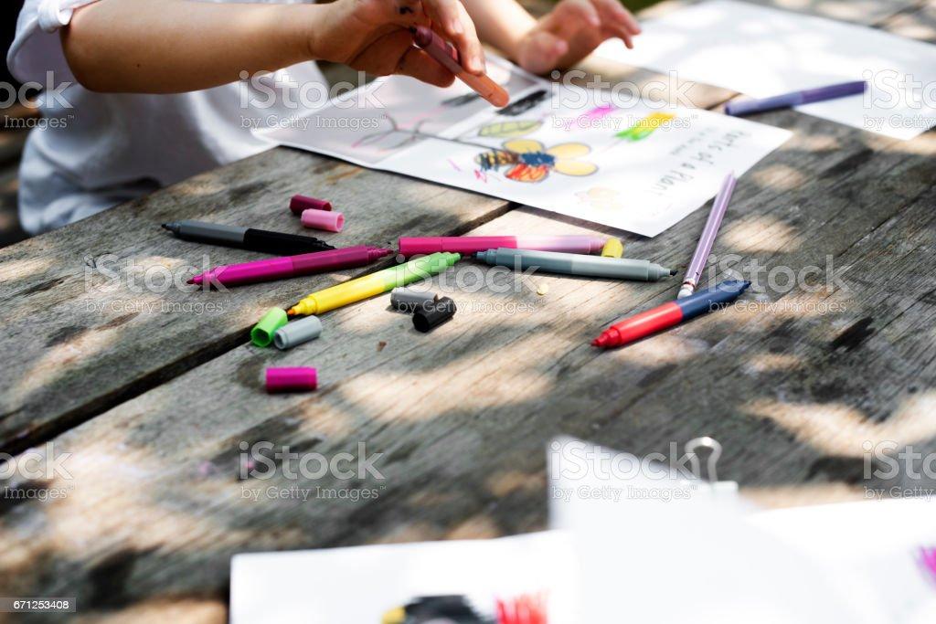 Group of kindergarten kids friends drawing art class outdoors