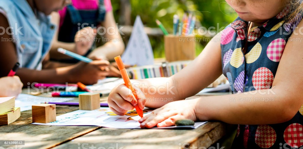 Group of kindergarten kids friends drawing art class outdoors stock photo